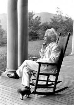 Samuel Clemens {Mark Twain} at Stormfield, with kitten