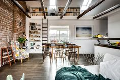 Attic apartment with exposed brick wall and exposed beams