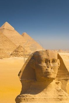 The Giza pyramids and a closeup of the head of the great Sphinx in Cairo, Egypt