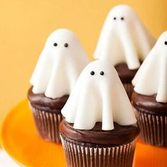 Ghost Cupcakes. Create these adorable ghosts with white fondant.