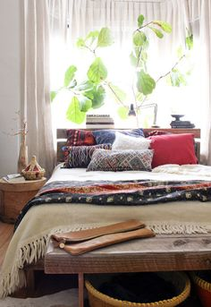 Idea for Bedding. Simple white comforter, eclectic mix of pillows, and a coral colored throw across the bottom of the bed