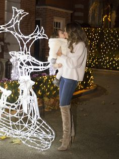 Feeling festive!Sophia seemed more than impressed with her mum's efforts, gazing up at aw...