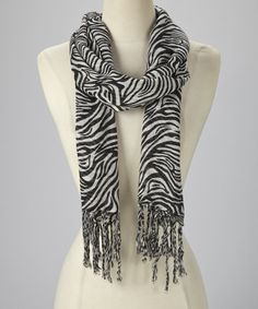 Give+pesky+breezes+the+cold—and+fierce—shoulder.+With+bold+stripes+and+finished+with+braided+fringe,+this+soft+scarf+makes+an+attitude-packed+accessory.