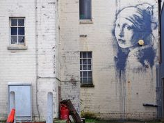 """A new work by Banksy called """"Girl with a Pierced Eardrum"""" has appeared on a wall in his home city of Bristol - and it has already been defaced."""