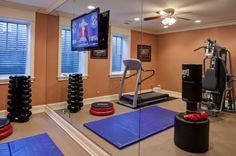 mirror wall in basement work out room- 25 Excellent Ideas For Designing Motivational Home Gym...wondering if we should rearrange our gym equipment...