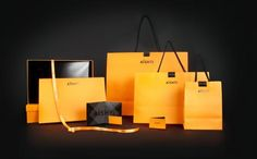 Aishti Identity Stationary system, bags, gift boxes, gift card, tissue paper, and logo for luxury department store Aishti based in the Middle East. Stationary materials were foil stamped with black + orange foils. Inside of the bags were printed with kissing couples. The boxes are personalized, everyone who shops at the store gets a custom label with their name printed on the orange gift box.