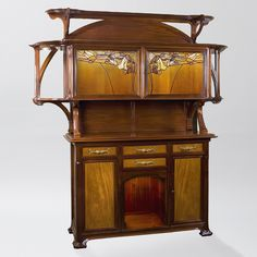 A French Art Nouveau mahogany and walnut buffet by Paul BEC, featuring 2 leaded glass doors depicting leaves and flowers. Similar buffet pictured in: The Paris Salons 1895-1914. France, circa 1900 (hva)