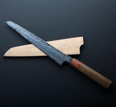 Hammered Sujihiki 200mm by custom chef knife maker Bryan Raquin.