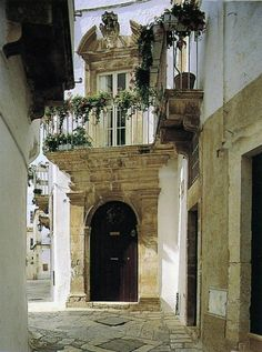 ".A quaint corner in Puglia, Italy, photographed by Valentina Cirasola, that leaves me speechless. (Except to say, ""that broken pediment is perfect!"")"