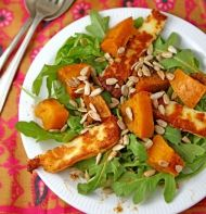 Recipe for Masala Roasted Pumpkin Salad, served with spicy rocket and salty Halloumi