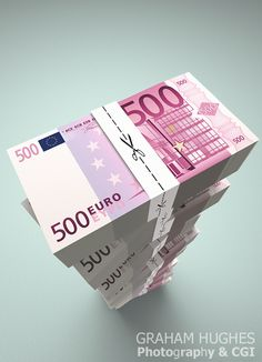 Large stack of Euro dollar bills with money ties with scissors cutting along dotted line.