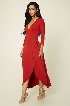 A stretch-knit maxi dress featuring a surplice front, a faux-wrap skirt, and 3/4 sleeves.