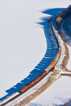 Snaking through a snowy landscape by train.