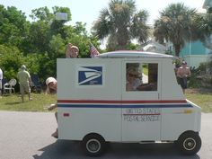 golf cart float turned into mail truck complete with candy filled envelopes to throw to the crowd