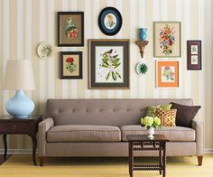 """Mix-and-Match Gallery  Gallery arrangements are easy solutions for blank walls. Give the display interest by including more than just framed art, such as the vase and plates used in this living room. Start by defining the dimensions of your display. Position the most prominent piece at eye level in the center and work outward. """"If you're using different frames, spread them out to give a little breathing room between each piece,"""" Crisolo recommends."""