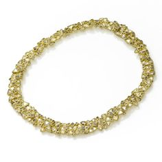 Todd Reed necklace: 18ky gold, naturally colored raw diamond macles (38.89ctw), 2mm raw diamond cubes (25.2ctw). Hand forged and fabricated