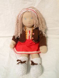 Maya is Waldorf inspired doll made from natural materials. She is about 23 tall (60cm) and she weighs about 1.2 lb (almost 0.6kg).  She is filled with