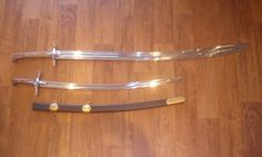 Two Kilij sabres - 2mm blunted edges, rounded tips, as is required by the HMBIA rule-set for bladed weapons. Forged to exact specifications by Viktor Berbekucz, Hungary.