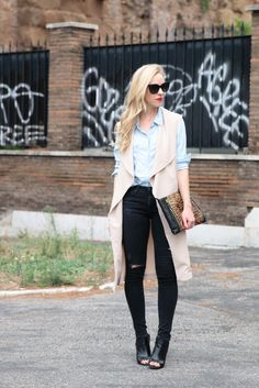 Edgy Denim: long trench vest, chambray shirt, Adriano Goldschmied distressed black jeans, oversized leopard clutch, peep toe booties, trench vest outfit, long vest outfit