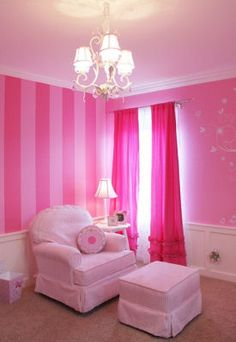 Pretty pink striped baby girl nursery looks almost like Meleighas room I might try painting one wall solid like that I like it better