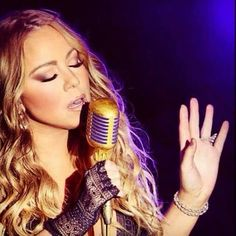 Mariah Carey - Her music always makes me feel better if I am feeling down =)