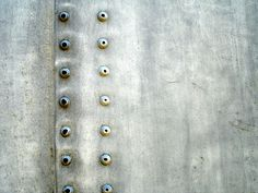 Closeup of rivets on an antique airplane. Homestuck Characters, Homestuck Trolls, Metal Mesh, Metal Art, Bike Cog, Sheet Metal Fabrication, Metal Projects, Nose Art, Cool Eyes