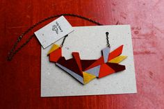 Cool felt shapes necklace. I like the color combo.