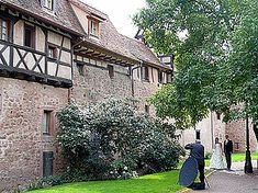 Some of our vacation rental apartments are in the most picturesque part of the ramparts of Riquewihr. Here a photographer is shooting the official wedding photos for a local young couple just married.