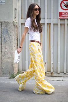 a fitted white tee with flowing printed yellow pants