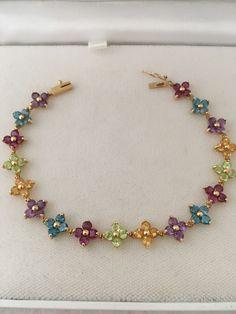A personal favorite from my Etsy shop https://www.etsy.com/listing/286551387/14k-gold-72-gemstones-flower-design