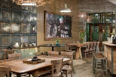 OMG!!! I love so many things about this...suh-weet tables! Awesome tile & tin.  Love the bar & stools.  Great light fixtures.