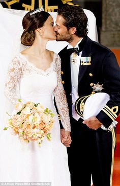 Prince Carl Philip leans in for his first kiss with his new bride