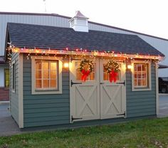 Garden Shed with 9-Lite Wood Windows, Carriage House Doors, Lap Siding, and Cupola http://www.backyardunlimited.com/sheds/garden-sheds