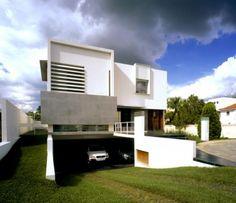 Minimalist Architectural Home Design With Basement Garage