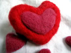 Felt Valentine Heart Pendant Charm  This little heart was needle felted out of hand dyed merino wool. It can be used on a necklace, key-chain, zipper, bracelet or tied with ribbon on a gift or attached to a card. The possibilities are endless! Being 100% merino wool, it is soft to attach to any next to skin items. At the top there is a split ring attached for ease of attaching it to whatever you wish.  $8.00
