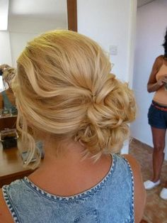 Side swept low bun