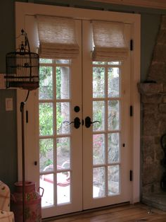 Love the Roman Shades on French doors.