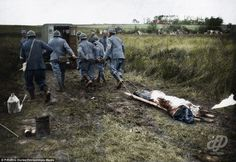 French troops move a dead comrade for burial