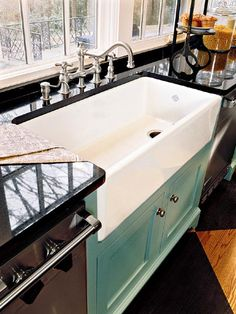 porcelain farm sink. Looks like the faucet I have now, love the sink and the color on the cabinet!