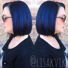 Vivid blue and purple hair. Asymmetrical bob