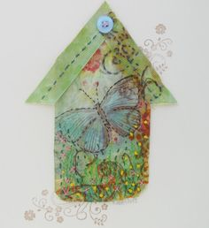 miniature birdhouse shaped embroidered (original) art work featuring a Butterfly design. No two design are ever the same! Mounted on Antique