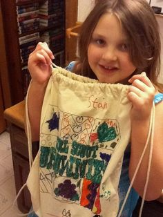A happy, young Colortime fan showing off her incredible decorating and coloring skills on our Girl Scout Brownies backpack!  http://www.colortime.com/c15/Girl-Scout-Brownies-Backpack-p215.html