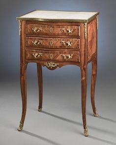 This exceptional Louis XV-period chiffoniere is comprised of the most luxurious materials The marble-top table boast intricate parquetry and doré bronze mounts Circa 1750