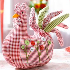 Cute, but I think I'd do real feathers for the tail of this rooster pincushion.