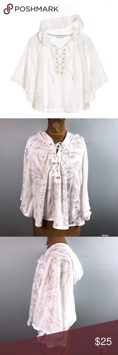 Victoria's Secret Lace Up Hooded Cover Up (012) STYLE: Hooded poncho coverup   COLOR: White palm burnout ivory  SIZE: Large  CONDITION: Preowned/Used- Excellent condition with no damage or stains. Victoria's Secret Swim Coverups