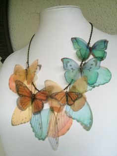 Completely hand-made necklace, with silk organza butterflies and wings. I chose butterfly images one by one, from real pictures and vintage illustrations. Then I printed them on high quality silk organza, cut and fixed on antique bronze chain.  Feminine.. ethereal.. light.. and romantic. Simply beautiful! OOAK  I love to create these unique pieces of jewelry. Please pay attention when you wear the necklace. It is very delicate. Don't stretch butterflies. Butterflies can't be washed but they…