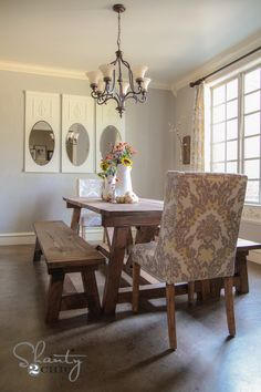 love the rustic table and feminine damask chair - also the greys :)