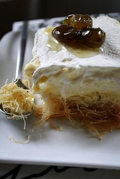 Ekmek Kataifi: it's three layers (a Kataifi pastry base soaked in syrup, a custard filling and fresh whipped cream topping) make a divinely delicious dessert … a little bit of heaven in every bite. Greek Sweets, Greek Desserts, Just Desserts, Delicious Desserts, Dessert Recipes, Yummy Food, Armenian Recipes, Turkish Recipes, Greek Recipes