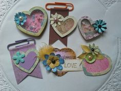 Embellies - Shaker Hearts & Paper Clips... made out with paper scraps.