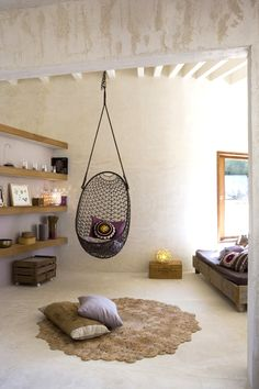 hanging chair, Moroccan style living room, neutrals, purples, via style files